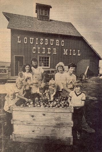Old black and white photo of families at Louisburg Cider Mill