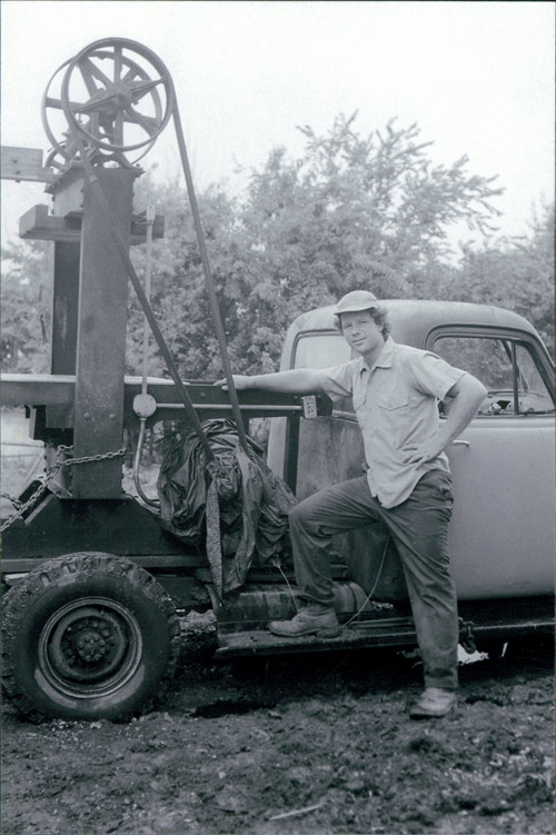 Tom with early apple press on truck