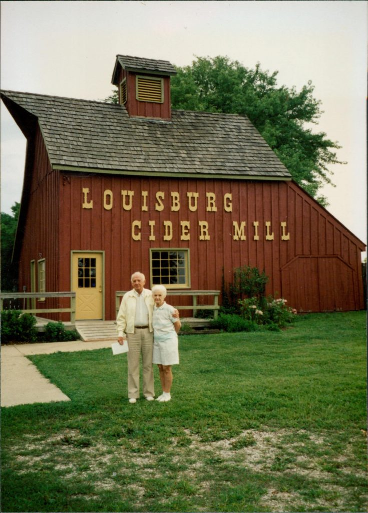 Owners of Louisburg Cider Mill in front of the Cider Mill barn
