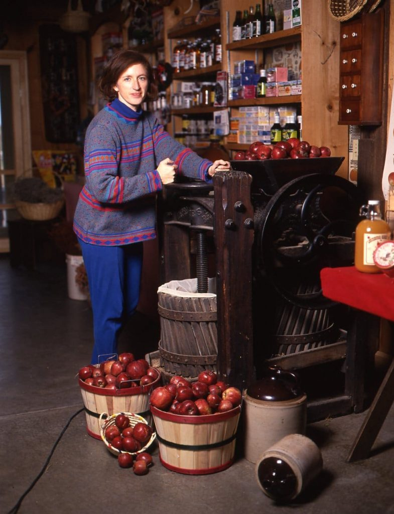 Shelly posing in front of the fruit press