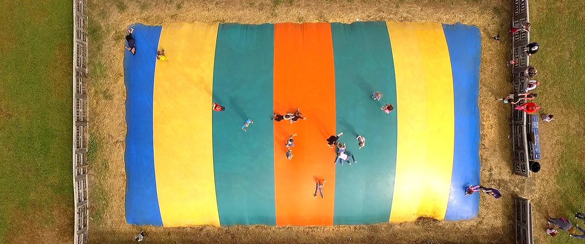 Giant multi-colored Jump pillow at Ciderfest