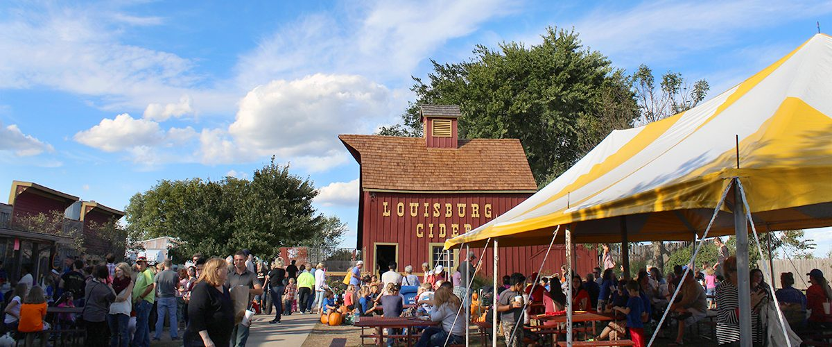 Crowds of people enjoying Ciderfest at Louisburg Cider Mill